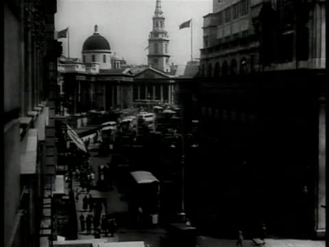above street w/ traffic moving up toward st. martin-in-the-fields church. - 1930 video stock e b–roll