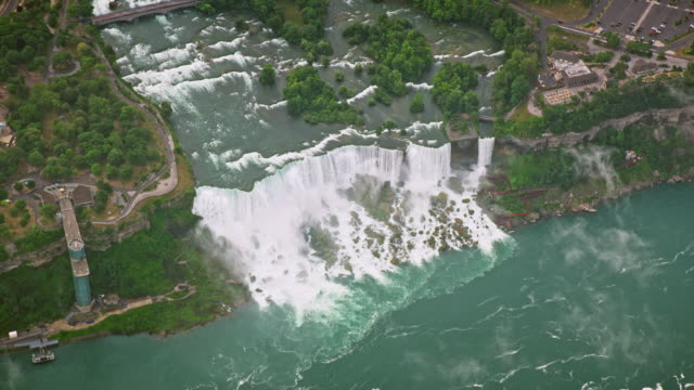 aerial above the american falls and the bridal veil falls on the niagara river in usa - river niagara stock videos & royalty-free footage