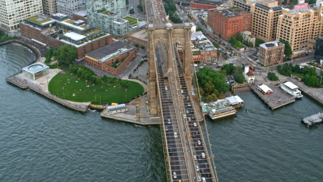 aerial above the brooklyn bridge in nyc - brooklyn bridge stock videos & royalty-free footage