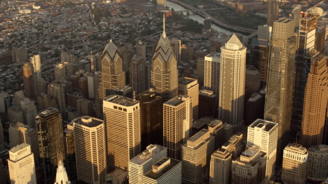 aerial above the center city, philadelphia in the morning sun - center city philadelphia stock videos and b-roll footage