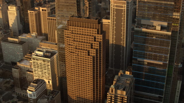 aerial above the center city skyscrapers in philadelphia, pa at sunrise - center city philadelphia stock videos and b-roll footage