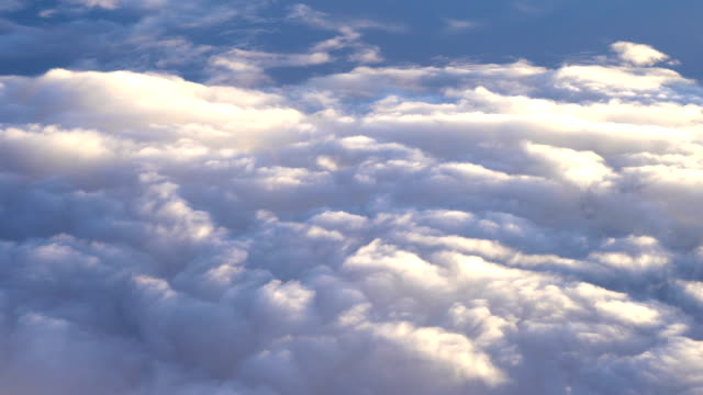 above the clouds from aircraft point of view - inquadratura da un aereo video stock e b–roll
