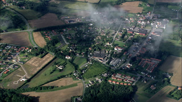 above the clouds over brenderup  - aerial view - south denmark, middelfart kommune, denmark - overhead projector stock videos & royalty-free footage