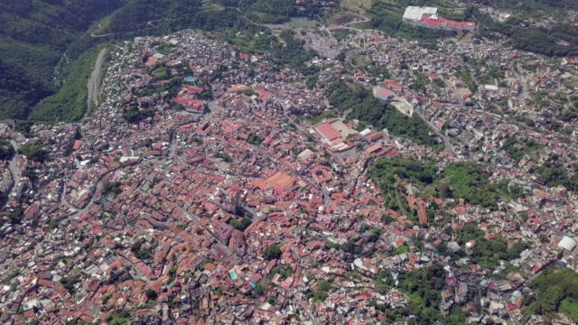 above the clouds panoramic shot of taxco city - colonial stock videos & royalty-free footage