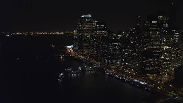 Above the East River at night, flying toward Lower Manhattan Financial District. Shot in November 2011.