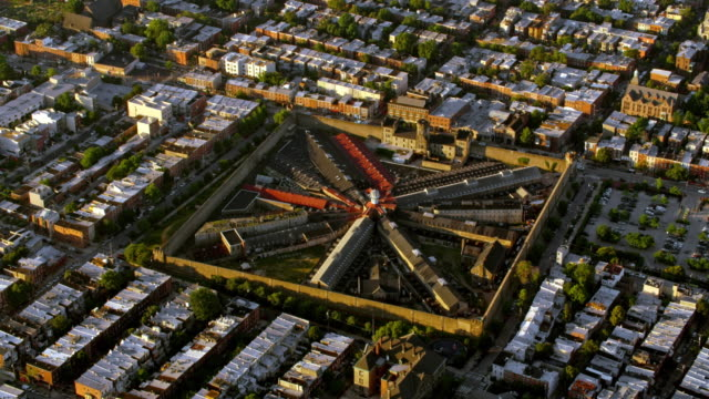 aerial above the eastern state penitentiary, philadelphia, a historical site and museum - eastern state penitentiary stock videos & royalty-free footage