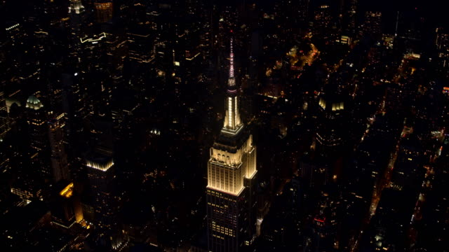 AERIAL Above the Empire State Building shining at night