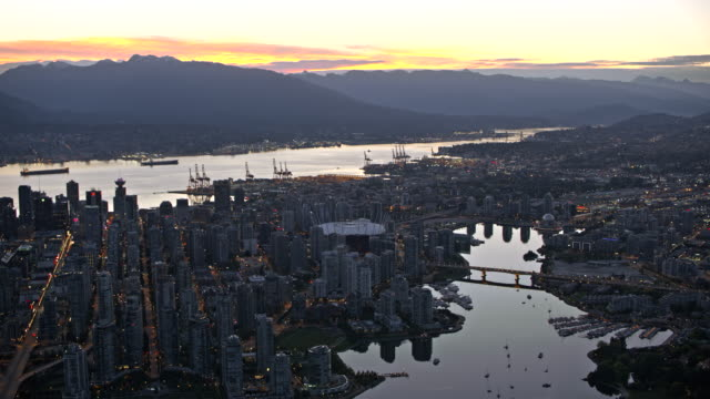 AERIAL Above the False Creek and Vancouver at dusk