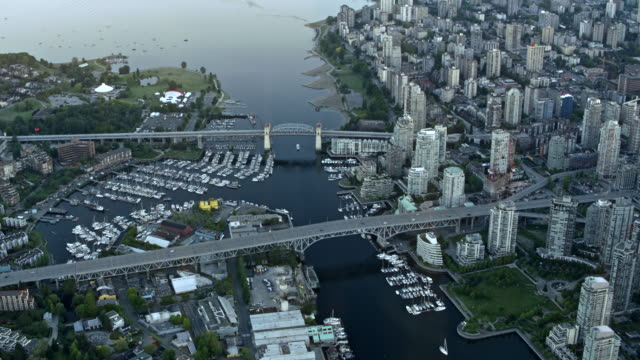 aerial above the false creek in vancouver with granville and burrard street bridge - vancouver canada stock videos and b-roll footage