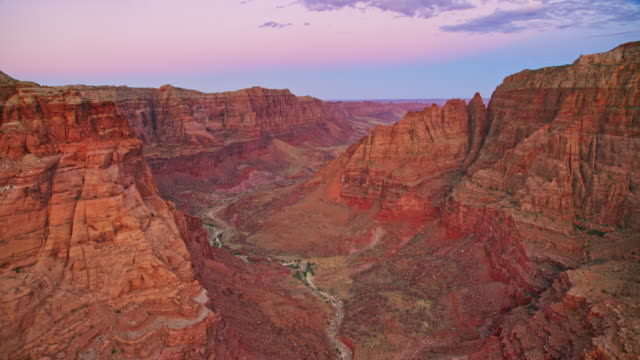 aerial above the grand canyon as the sun is setting - grand canyon national park stock videos & royalty-free footage