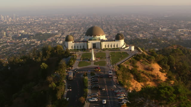 aerial above the griffith observatory in los angeles, ca - famous place stock videos & royalty-free footage