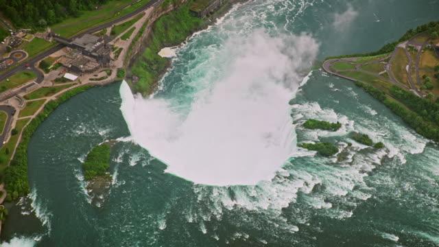 aerial above the horseshoe falls on the niagara river - river niagara stock videos & royalty-free footage