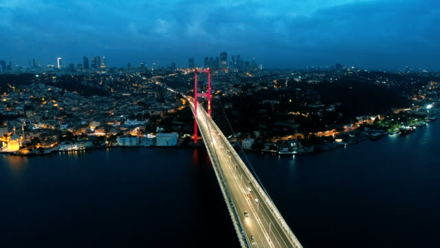 above the istanbul bosphorus bridge (lights on) - ponte video stock e b–roll