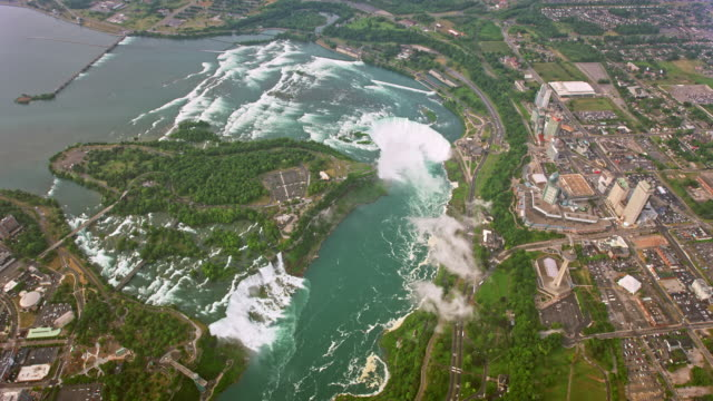 aerial above the niagara river and the niagara falls - river niagara stock videos & royalty-free footage