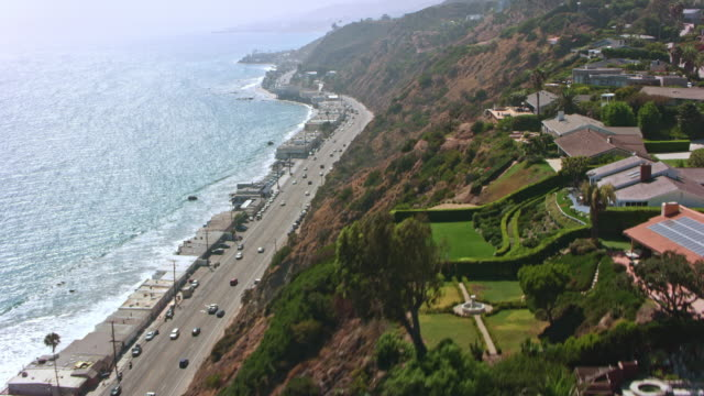 aerial above the pacific coast highway in california - malibu stock videos & royalty-free footage