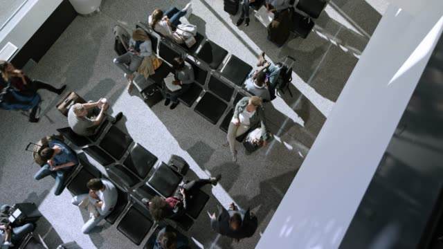 ds above the passengers waiting in the gate lobby - airport terminal stock videos & royalty-free footage