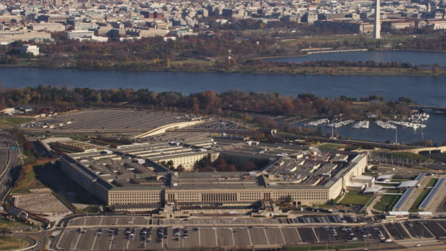 above the pentagon with a glimpse of washington dc in background. shot in 2011. - the pentagon stock videos and b-roll footage