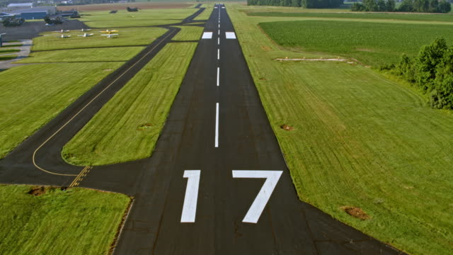 aerial above the runway before landing - airport runway stock videos & royalty-free footage