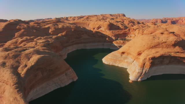 aerial above the sandstone hills surrounding lake powell - lake powell stock videos & royalty-free footage