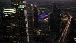 AERIAL Above the skyscrapers in Downtown Los Angeles at night
