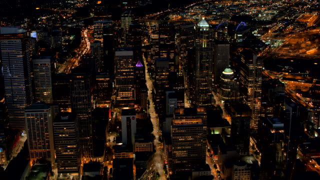 AERIAL Above the streets in Downtown Seattle at night