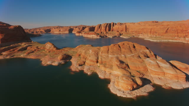 aerial above the water surface of lake powell, usa - lago powell video stock e b–roll