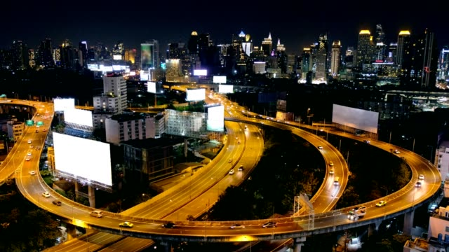 above view of car driving on expressway with billboards in downtown at bangkok city - tabellone video stock e b–roll