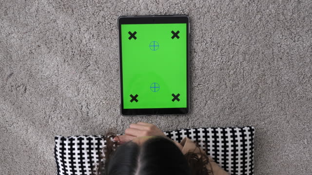 Above view of Using digital tablet, Green screen