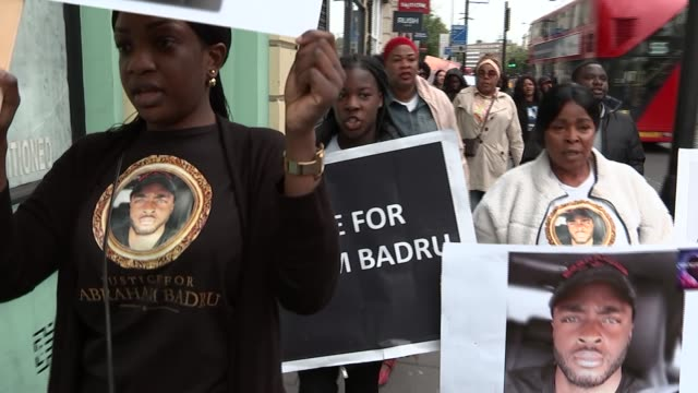 Family march through Hackney and appeal for information ENGLAND London Hackney EXT Various shots of family and friends of Abraham Badru along holding...