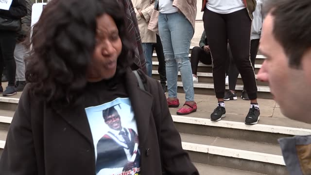 Family march through Hackney and appeal for information ENGLAND London Hackney EXT Toyin Ali interview SOT Family and friends of Abraham Badru...