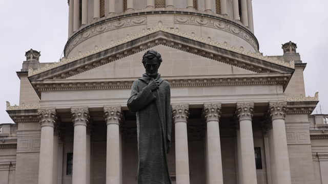 abraham lincoln statue on the grounds of the west virginia state capitol building, sunday, january 17, 2021 in charleston, west va. protesters were... - virginia us state stock videos & royalty-free footage