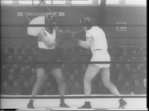 abraham simon 240-pound heavyweight tunes up for return bouts with joe louis / simon sparring with partner / simon knitting / close up of simon... - pesi massimi video stock e b–roll