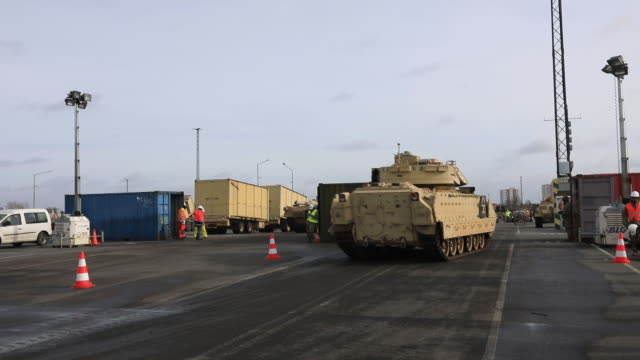 m1 abrams battle tanks and bradley infantry fighting tanks at bremerhaven port transported from us military for nato defender europe20 exercise... - waffe stock-videos und b-roll-filmmaterial