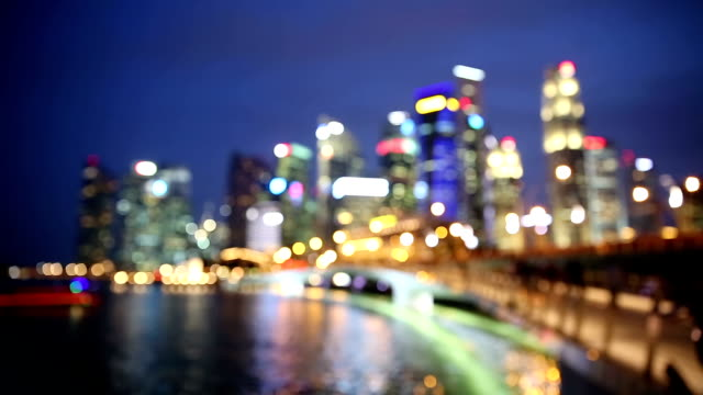 abstracr blurred background: singapore cityscape night - focus on foreground stock videos & royalty-free footage