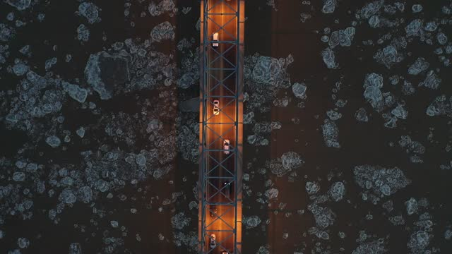 abstract aerial drone video of traffic at night on the binzhou yellow river highway bridge and river with flowing broken ice in shandong province.... - abstract stock videos & royalty-free footage