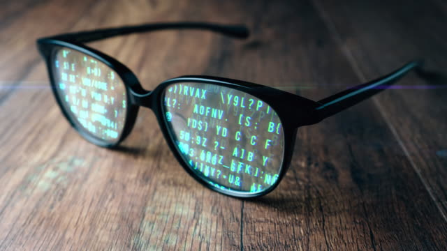 abstract animation digital computer code running in glasses - occhiali da vista video stock e b–roll