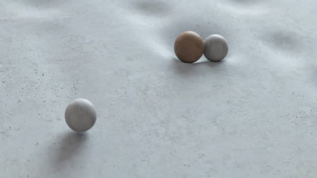 abstract animation of balls falling on a soft surface and rolling down from it. - marble stock videos & royalty-free footage