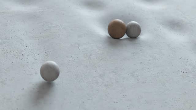 abstrakt animation av bollar som faller på en mjuk yta och rulla ner från den. - kula geometriformad bildbanksvideor och videomaterial från bakom kulisserna