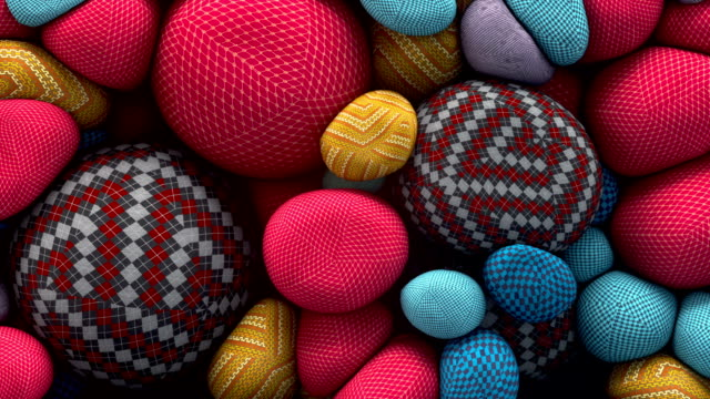 Abstract animation of colored floating spheres with a knitted texture. 3D rendering