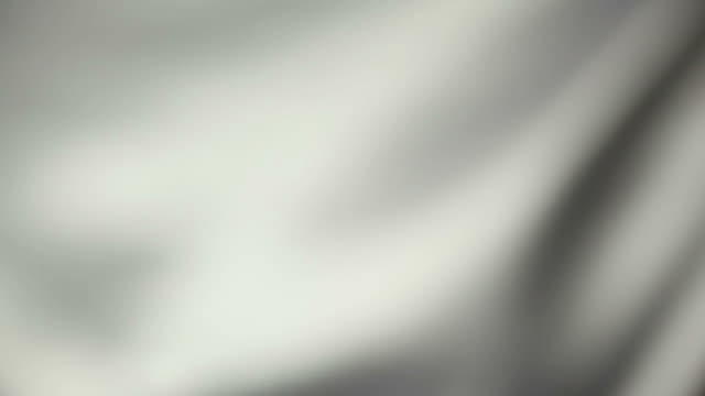 abstract background of white silk fabric in the wind - grey colour stock videos & royalty-free footage