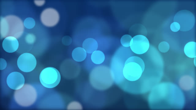 abstract blue circular bokeh background - defocussed stock videos & royalty-free footage