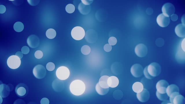 vídeos de stock e filmes b-roll de abstract blue clean blurred soft glitter dust tiny moving rising glitter bokeh particles loopable background - animation moving image