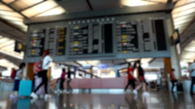 abstract blur flight information at a timetable at airport . - airport terminal stock videos & royalty-free footage