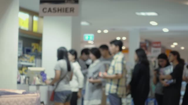 abstract blur, the crowd or people at cashier counter of shopping mall. - cashier stock videos & royalty-free footage