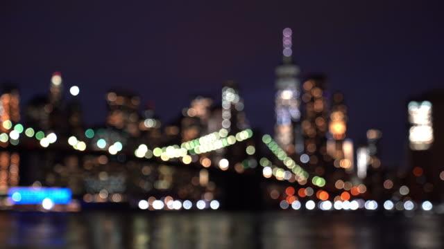 abstract blurred background brooklyn bridge at sunset twilight, new york city ny usa - brooklyn bridge stock videos & royalty-free footage