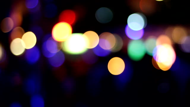 Abstract blurred beautiful with bokeh lights background. Defocused and selective focus LED light.