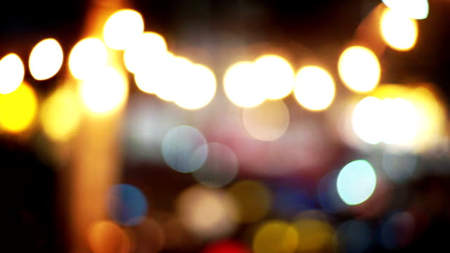 abstract blurred beautiful with bokeh lights background. defocused and selective focus led light. - soft focus stock videos and b-roll footage