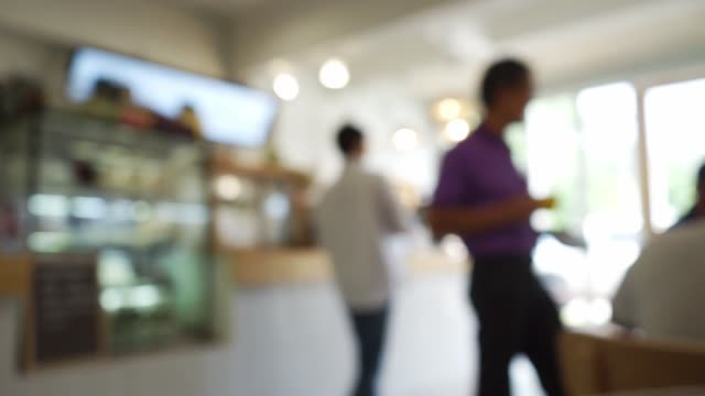 abstract blurred in coffee shop - coffee shop background stock videos & royalty-free footage