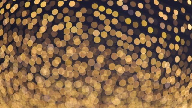 vídeos y material grabado en eventos de stock de fondo bokeh abstracto con cálidas luces de colores. - gala