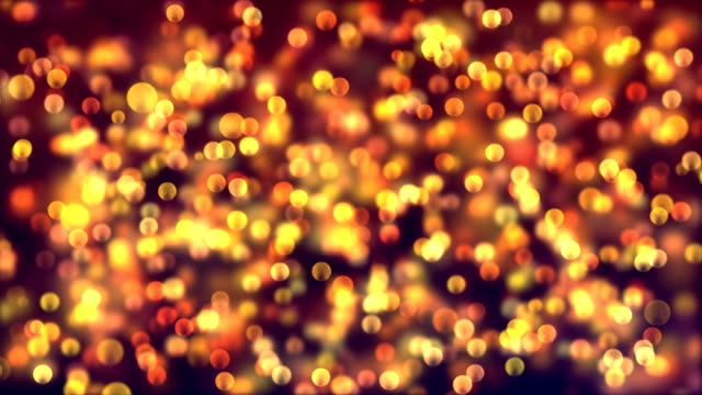 abstract bokeh particles background with infinite loop - glowworm stock videos & royalty-free footage